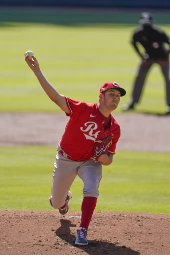 Cincinnati Reds starting pitcher Trevor Bauer (27) delievers in first inning against the Atlanta Braves during Game 1 of a National League wild-card baseball series, Wednesday, Sept. 30, 2020, in Atlanta. (AP Photo/John Bazemore)