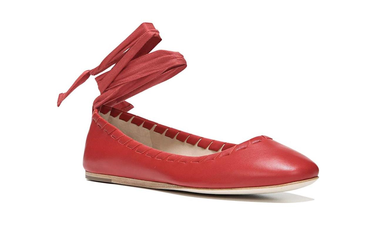 """<p>This round-toe flat features a cushioned insole for added comfort, and the red-hot shade will stand out in a sea of black footwear. Also, the ankle ribbon is removable.</p> <p>To buy: <a rel=""""nofollow"""" href=""""http://www.anrdoezrs.net/links/7876402/type/dlg/sid/TLFASG1TravelFlatsDZApr17/http://www.6pm.com/p/via-spiga-baylie-fireball-red-nappa/product/8844607/color/675715"""">6pm.com</a>, $90</p>"""