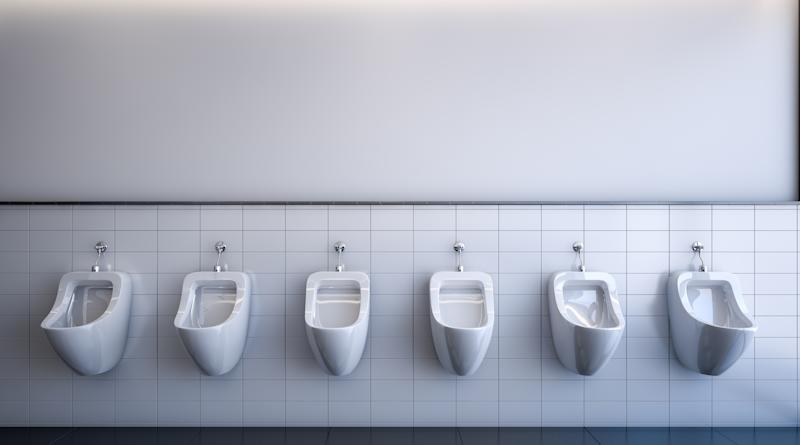 White urinals in a public restroom