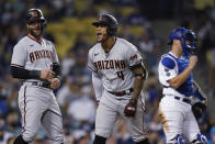 Arizona Diamondbacks' Ketel Marte, center, celebrates his three-run home run with Christian Walker, left, during the seventh inning of the team's baseball game against the Los Angeles Dodgers on Tuesday, Sept. 14, 2021, in Los Angeles. (AP Photo/Marcio Jose Sanchez)