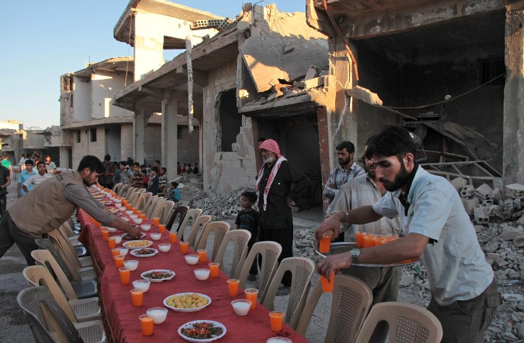 The fast-breaking meals provide a rare respite from the horrors of Syria's six-year war (AFP Photo/Hamza Al-Ajweh)