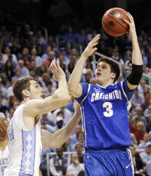 FILE -In this March 18, 2012 file photo, Creighton's Doug McDermott (3) shoots over North Carolina's Tyler Zeller during the first half of a third-round NCAA tournament college basketball game in Greensboro, N.C. McDermott and Indiana sophomore center Cody Zeller are the leading vote-getters on The Associated Press' preseason All-America team, announced Monday, Oct. 29, 2012. (AP Photo/Chuck Burton, File)