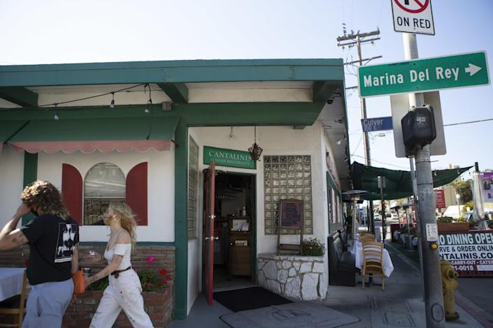 People walk past the exterior of Cantalini's Salerno Beach Restaurant