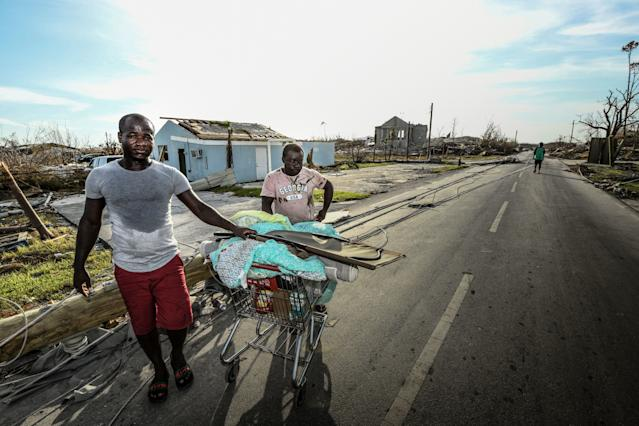 """<div class=""""caption""""> Two Haitian cousins say they had lost everything and have no place to go. """"Without papers"""" they feared heading to Nassau because of the potential of being sent back to Haiti. </div> <cite class=""""credit"""">Dom Furore</cite>"""