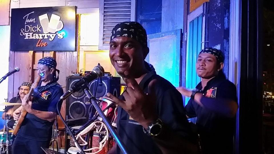 Happy times: Sanjiv with his band performing at a local bar. ― Picture courtesy of Aseana Percussion Unit (A.P.U)