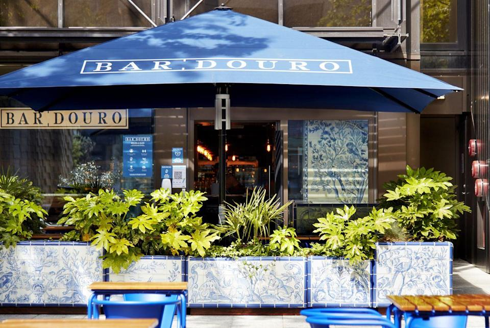 """<p>For those missing a slice of Portugal, rustic <a href=""""https://www.bardouro.co.uk/city"""" rel=""""nofollow noopener"""" target=""""_blank"""" data-ylk=""""slk:Bar Douro City"""" class=""""link rapid-noclick-resp"""">Bar Douro City</a> draws inspiration from traditional Portugese cuisine. Dine on croquetes de alheira (smoked Portuguese sausage) and bacalhau a bras (salt cod hash) as you dream of being further afield. </p>"""