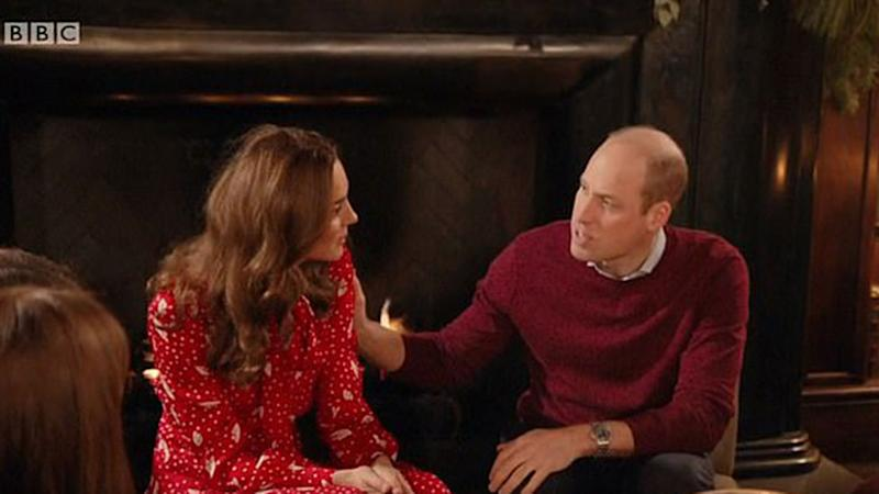 Prince William touches Kate Middleton's shoulder on BBC documentary.