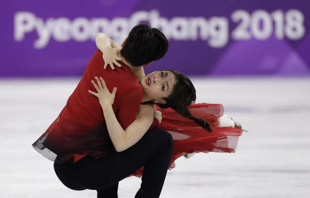 Alex Shibutani (left) and Maia Shibutani perform during the ice dance, free dance figure skating final. (AP)