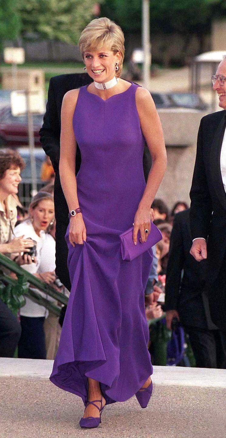 <p>Princess Diana wore Rapunzel's signature color to a gala in Chicago in 1996. She paired her sleeveless gown with a coordinated purple clutch and sparkling jewelry, as one does.</p>