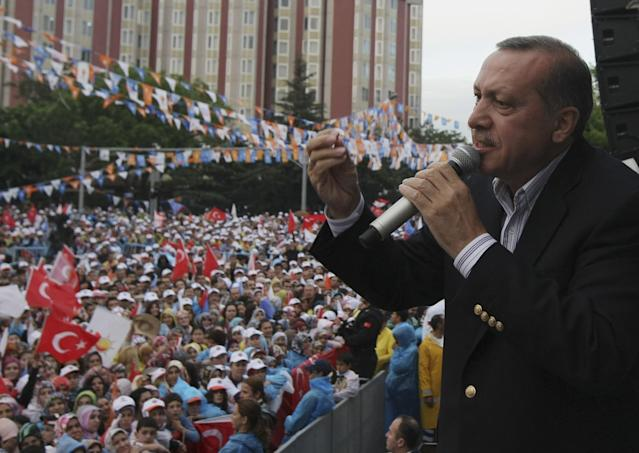 <p>Turkish Prime Minister Recep Tayyip Erdogan addresses the supporters of his Islamic-rooted Justice and Development Party during an election rally in Ankara on May 29, 2011. (AP Photo/Burhan Ozbilici) </p>