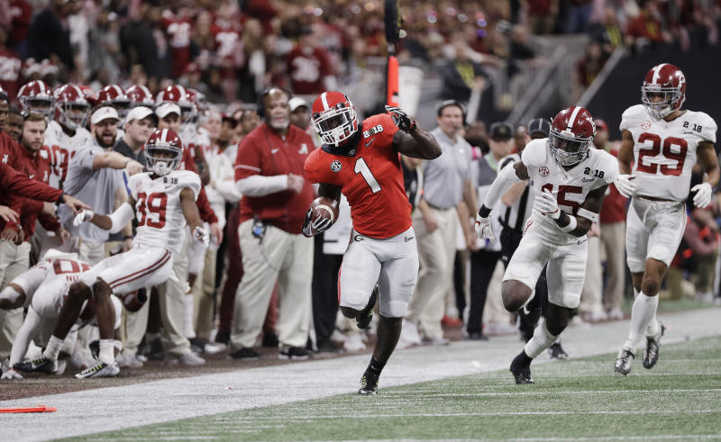 Sony Michel's performance in two playoff games erased any thoughts of him becoming a sleeper pick in the NFL draft. (AP)