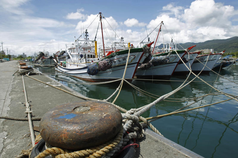 Fishing boats sit in the protection of the harbor as they wait out approaching Typhoon Tembin in the coastal village of Ilan, Taiwan, Thursday, Aug. 23, 2012. More than 1,000 residents were evacuated from mountainous areas of Taiwan as the typhoon approaches the island, threatening to dump rains that could unleash deadly landslides. (AP Photo/Wally Santana)