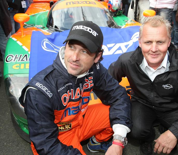 """FILE - In this June 9, 2011 file photo, actor Patrick Dempsey, left, and British driver Johnny Herbert pose for photographs in front of the Mazda 787 B, which won the race in 1991, in Le Mans, western France. Dempsey is producing and will be featured in """"Road to Le Mans,"""" a Velocity channel series that will follow the actor-race car driver as he prepares for the famed auto endurance race. (AP Photo/Vincent Michel, file)"""