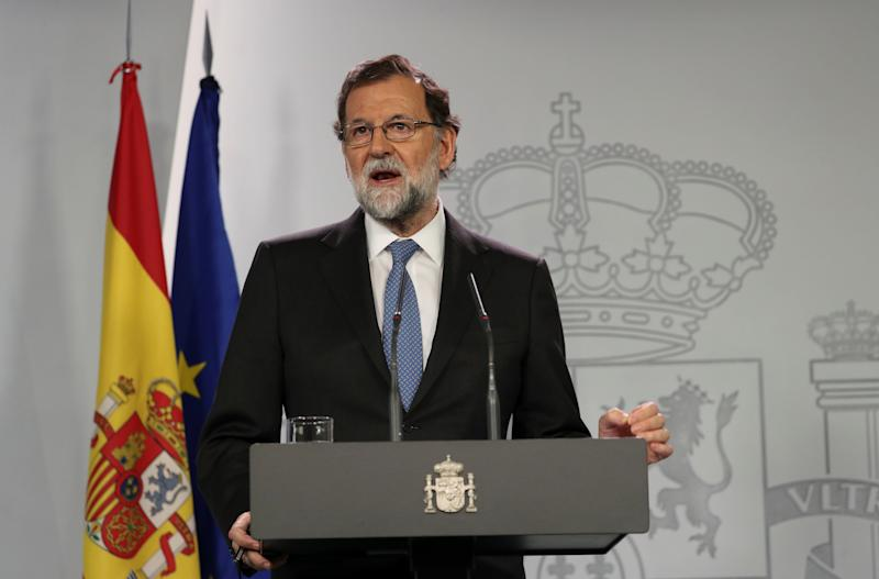 Spain's Prime Minister Mariano Rajoy delivers a statement after an extraordinary Cabinet meeting at the Moncloa Palace in Madrid on Friday.