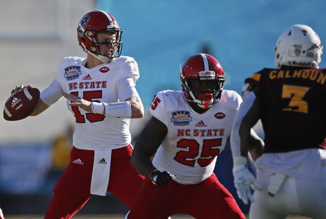 North Carolina State quarterback Ryan Finley, left, throws against Arizona State during the fist half of the Sun Bowl NCAA college football game in El Paso, Texas, Friday, Dec. 29, 2017. (AP Photo/Andres Leighton)