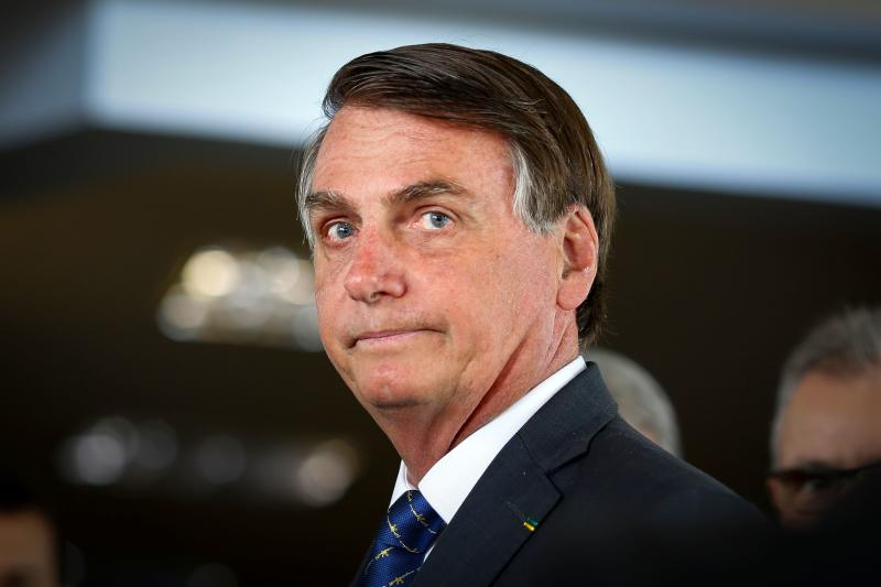 Brazilian President Jair Bolsonaro arrives for a press conference on electricity and gasoline at the Ministry of Mines and Energy in Brasilia, on January 15, 2020. - Bolsonaro spoke about Brazil's possible entry to the Organisation for Economic Co-operation and Development (OECD). (Photo by Sergio LIMA / AFP) (Photo by SERGIO LIMA/AFP via Getty Images)