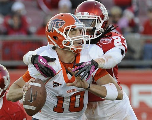 UTEP quarterback Blaire Sullivan (10) is grabbed by Houston defensive back Trevon Stewart (23) during the second half of an NCAA college football game Saturday, Oct. 27, 2012, in Houston. Houston won 45-35. (AP Photo/Pat Sullivan)