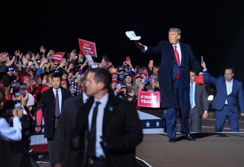 US President Donald Trump tosses a cap to supporters as he arrives for a campaign rally at Duluth International Airport in Duluth, Minnesota on September 30, 2020. - President Trump announced early on October 2, 2020, that he and First Lady Melania Trump would be going into quarantine after they were both found to have contracted the novel coronavirus. (Photo by MANDEL NGAN / AFP) (Photo by MANDEL NGAN/AFP via Getty Images)