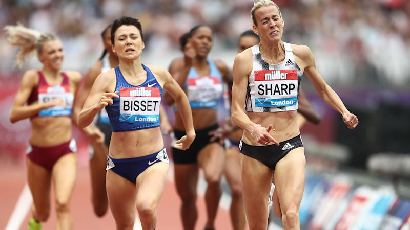 Lynsey Sharp (R) just edges Catriona Bisset (L) for gold in the 800m. (Photo by Bryn Lennon/Getty Images)