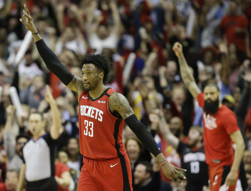 Houston Rockets forward Robert Covington (33) reacts after making a three point basket late in the second half of an NBA basketball game against the Utah Jazz, Sunday, Feb. 9, 2020, in Houston. (AP Photo/Eric Christian Smith)