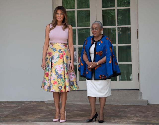 <p>Melania Trump stood next to the wife of President Uhuru Kenyatta of the Republic of Kenya, Mrs. Margaret Kenyatta, as the FLOTUS welcomed the leaders to the White House with her husband. For the occassion, she wore a £3,100 Valentino skirt and four-inch Louboutin heels. This outfit choice was amusing to some, especially as part of the days activities included a spot of gardening on the White House lawn.<br><em>[Photo: Rex]</em> </p>