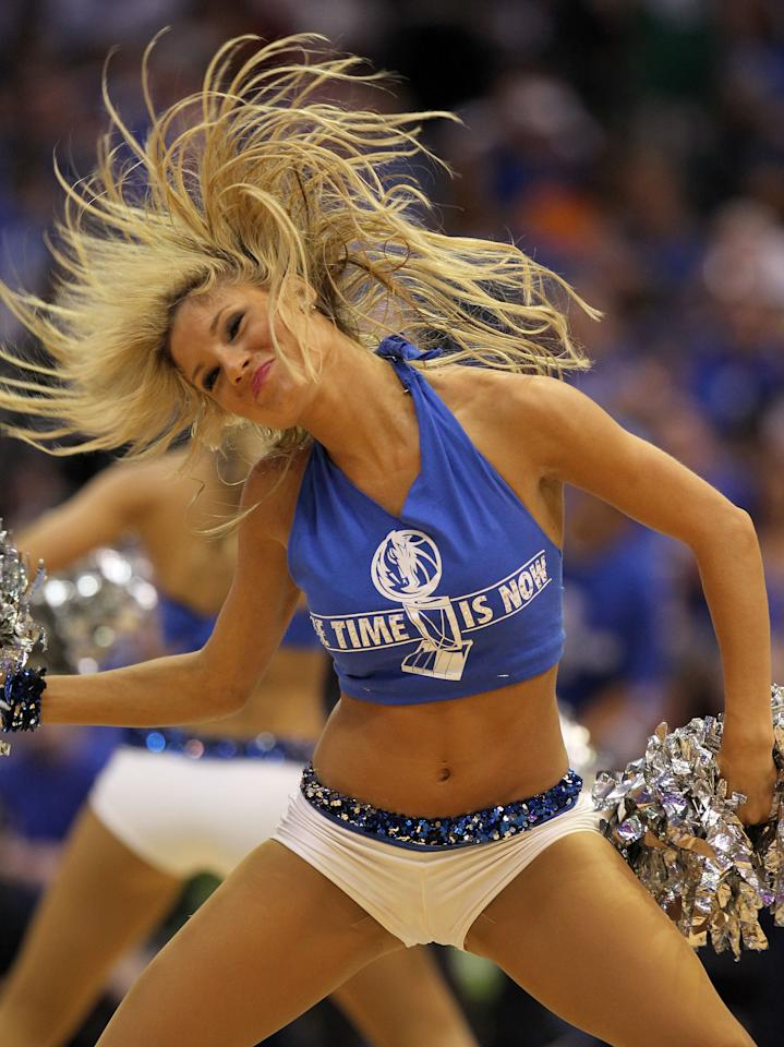 DALLAS, TX - JUNE 05:  A Dallas Mavericks dancer performs during a break in Game Three of the 2011 NBA Finals at American Airlines Center between the Mavericks and the Miami Heat on June 5, 2011 in Dallas, Texas.  NOTE TO USER: User expressly acknowledges and agrees that, by downloading and/or using this Photograph, user is consenting to the terms and conditions of the Getty Images License Agreement.  (Photo by Ronald Martinez/Getty Images)