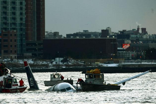 NEW YORK - JANUARY 15: Rescue boats float next to a US Airways plane floating in the water after crashing into the Hudson River in the afternoon on January 15, 2008 in New York City. The Airbus 320 flight 1549 crashed shortly after take-off from LaGuardia Airport heading to Charlotte, North Carolina. (Photo by Chris McGrath/Getty Images)