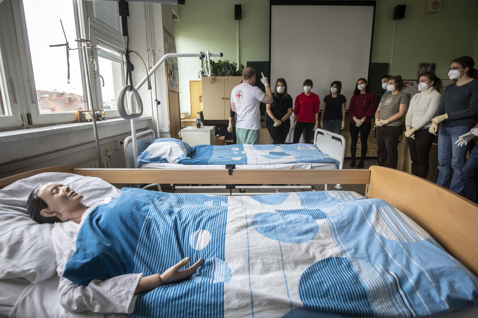 Image: People attend a training course for volunteers provided by the Red Cross to help in hospitals or pensioner houses during the pandemic on Oct. 28, 2020 in Prague, Czech Republic. (Gabriel Kuchta / Getty Images)