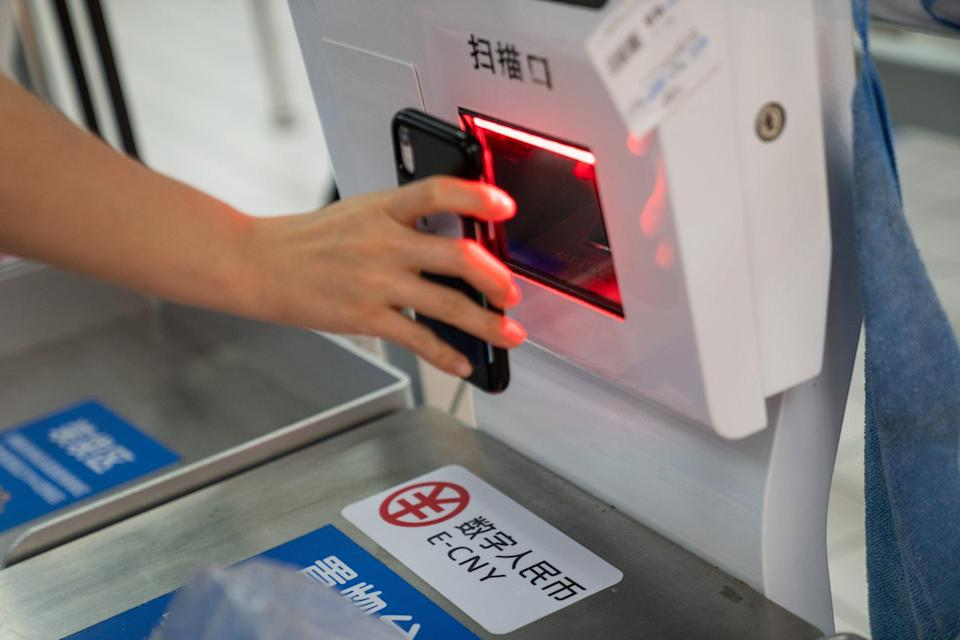 Signage for the digital yuan at a self checkout counter inside a supermarket in Shenzhen. China's central government wants to build a digital economy but first must ensure thatpersonal information is not abused. Photo: Bloomberg