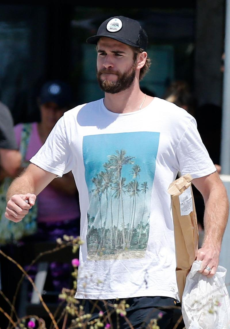 Liam Hemsworth has been seen sporting a band on his ring finger while out and about running some errands. Source: Mega