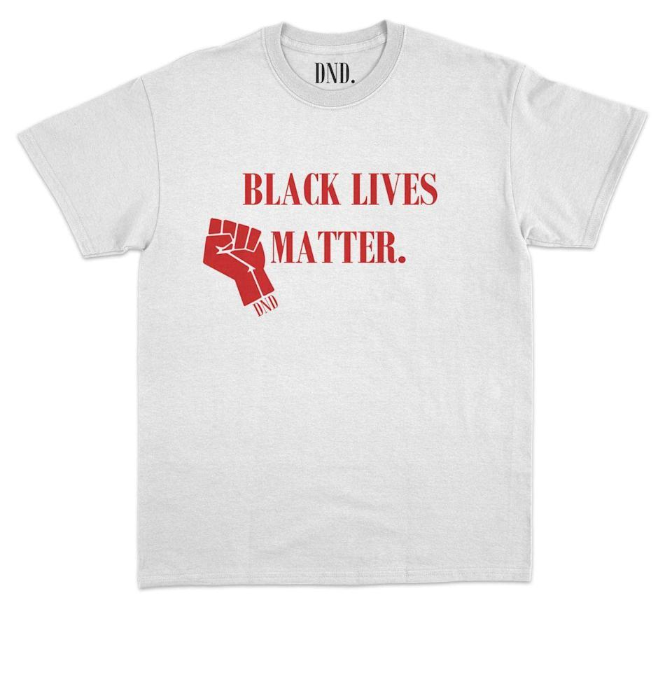 """<p><strong>Do Not Disturb</strong></p><p>shopdonotdisturb.com</p><p><strong>$39.99</strong></p><p><a href=""""https://www.shopdonotdisturb.com/product/black-lives-matter-worldwide-t-shirt-all-colors-options"""" rel=""""nofollow noopener"""" target=""""_blank"""" data-ylk=""""slk:Buy"""" class=""""link rapid-noclick-resp"""">Buy</a></p><p>A T-shirt that's got something worth saying, for the stepdad who's out there protesting. Proceeds from sales go to charity.</p>"""