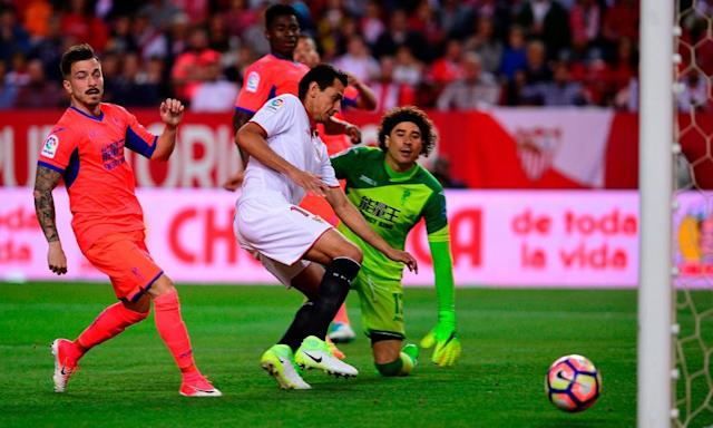 "<span class=""element-image__caption"">Paulo Ganso tucks in Sevilla's second goal during their victory over Granada.</span> <span class=""element-image__credit"">Photograph: Cristina Quicler/AFP/Getty Images</span>"