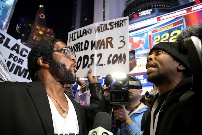 <p>A supporter of U.S. President-elect Donald Trump (L) argues with a man against Trump in Times Square, Manhattan, New York on Nov. 8, 2016. (Photo: Bria Webb/Reuters) </p>