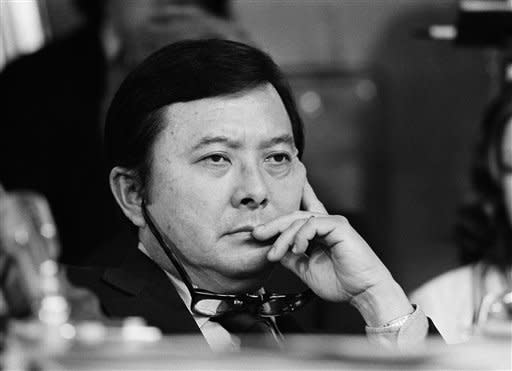 Sen. Daniel K. Inouye (D-Hawaii), with his glasses around his neck listens to testimony from L. Patrick Gray III, former acting director of the Federal Bureau of Investigation, before questioning Gray before the Senate Watergate committee, Aug. 6, 1973 in Washington. (AP Photo)