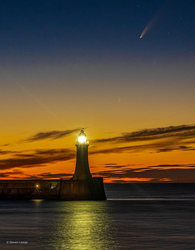 Comet Neowise passes over Roker Light House in Sunderland on 12 July 2020. See SWNS story SWBRcomet.