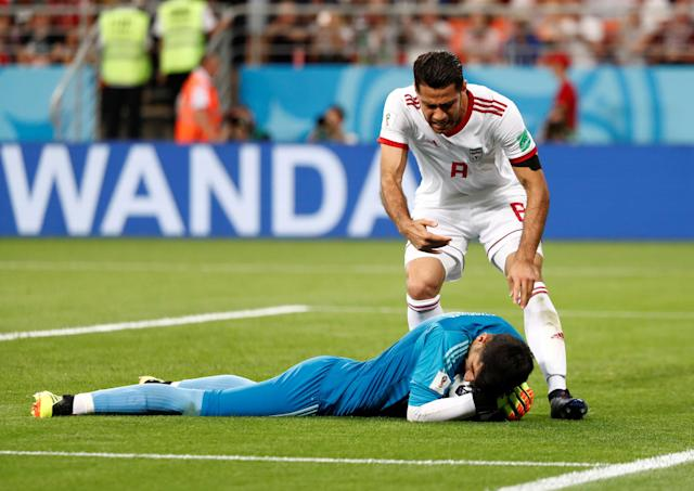 Soccer Football - World Cup - Group B - Iran vs Portugal - Mordovia Arena, Saransk, Russia - June 25, 2018 Iran's Alireza Beiranvand with Morteza Pouraliganji after saving a penalty by Portugal's Cristiano Ronaldo REUTERS/Murad Sezer