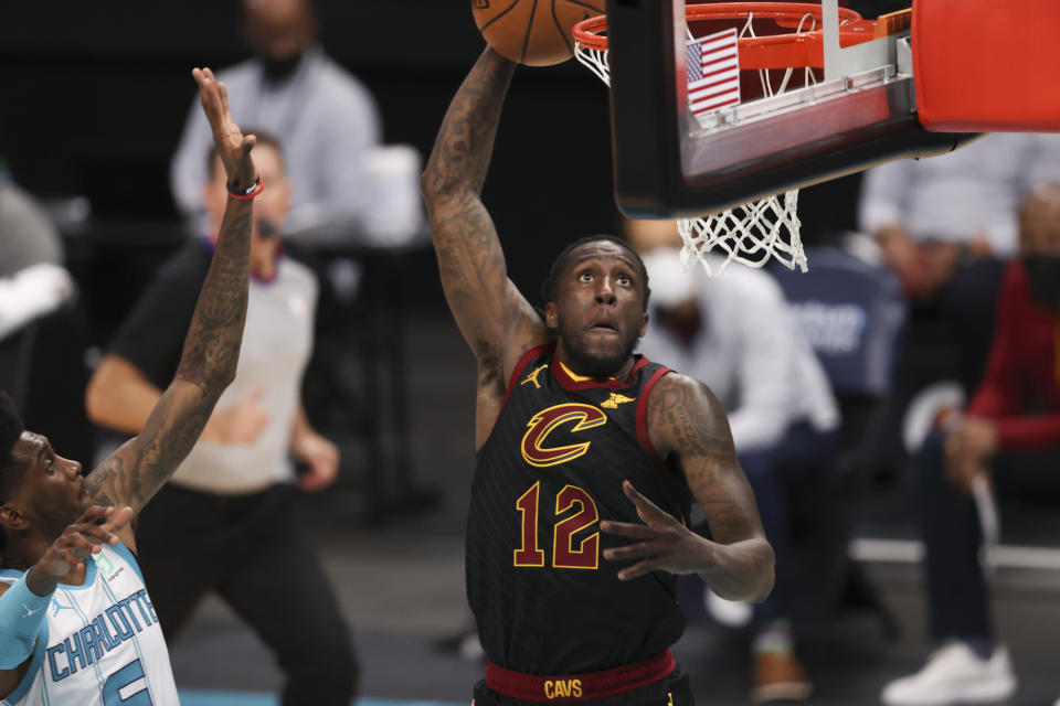 Cleveland Cavaliers forward Taurean Prince (12) dunks against the Charlotte Hornets during the second quarter of an NBA basketball game in Charlotte, N.C., Wednesday, April 14, 2021. (AP Photo/Nell Redmond)