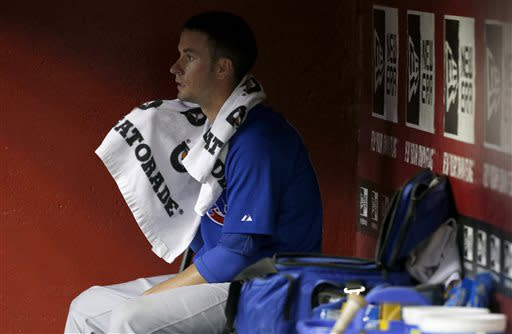 Chicago Cubs' Chris Rusin sits in the dugout in the fifth inning of a baseball game against the Arizona Diamondbacks on Monday, July 22, 2013, in Phoenix. (AP Photo/Ross D. Franklin)