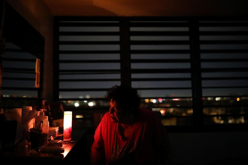 Carmen Correa uses a candle to light up a room at the Moradas Las Teresas Elderly House, where about two hundred elderly people live without electricity following damages caused by Hurricane Maria in Carolina, Puerto Rico, September 30, 2017. (Photo: Carlos Barria / Reuters)