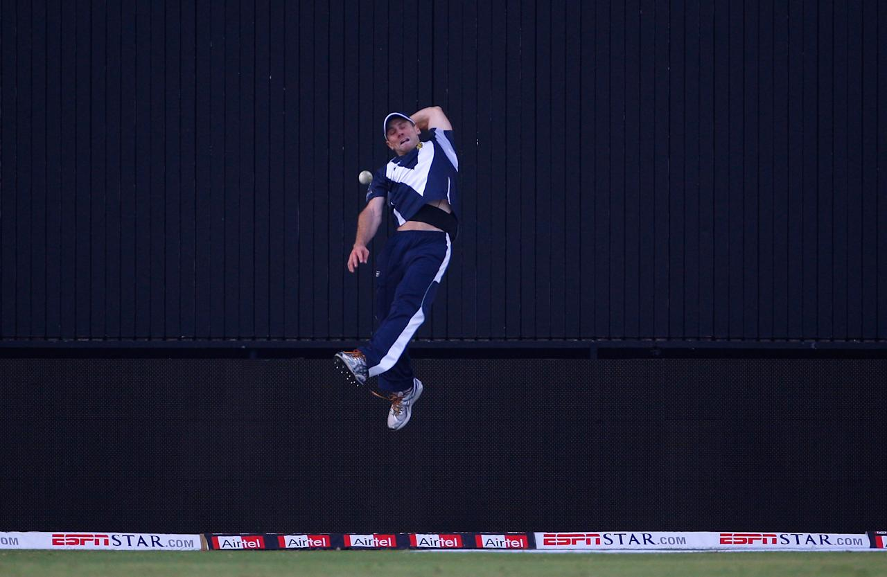 DELHI, INDIA - OCTOBER 13:  Bushrangers fielder Aiden Blizzard attempts to take a catch on the boundary during the Airtel Champions League Twenty20 group D match between Victoria Bushrangers and Wayamba Elevens at the Feroz Shah Kotla stadium on October 13, 2009 in Delhi, India.  (Photo by Stu Forster - GCV/GCV via Getty Images)