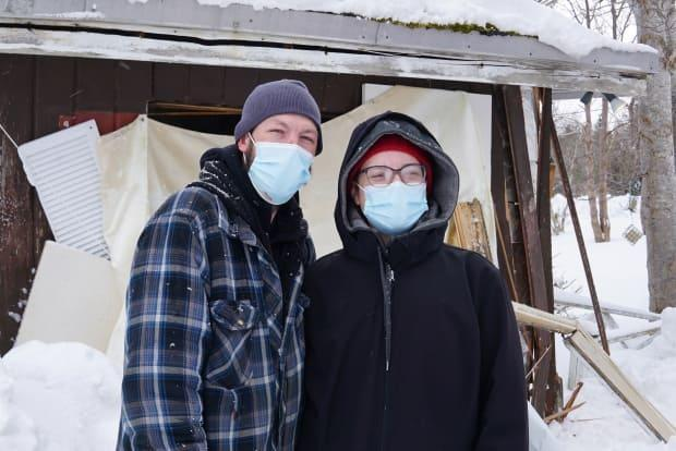 Cory Monk and Joella Dyke say they feel their landlord threatened them when he pushed forward with a front-end loader on Wednesday morning. (Ryan Cooke/CBC - image credit)