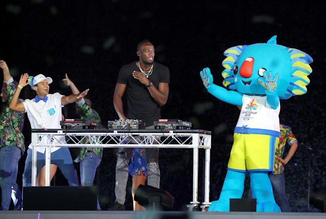 Gold Coast 2018 Commonwealth Games - Closing ceremony - Carrara Stadium - Gold Coast, Australia - April 15, 2018 - Former Jamaican sprinter Usain Bolt plays the DJ desks during the closing ceremony. REUTERS/Athit Perawongmetha