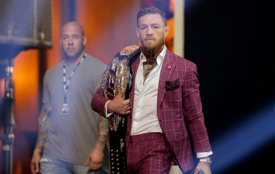 Conor McGregor arrives a news conference in New York, Thursday, Sept. 20, 2018. McGregor is returning to UFC after a two-year absence. He fights undefeated Khabib Nurmagomedov on Oct. 6, a bout certain to shatter UFC pay-per-view view records. (AP Photo/Seth Wenig)