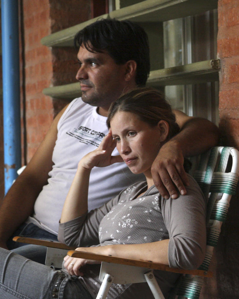 Analia Bouter and her husband Fabian Veron sit outside the hospital in Resistencia, Argentina, Wednesday April 11, 2012. Bouter found her baby alive in a coffin in the morgue nearly 12 hours after the girl had been declared dead. The tiny girl, born three months premature, was in critical but improving condition Wednesday in the same hospital where the staff pronounced her stillborn on April 3. (AP Photo/Juan Pablo Faccioli)
