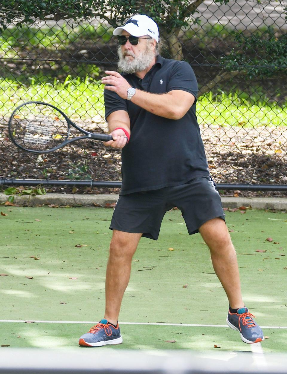 <p>Russell Crowe hits the tennis court with girlfriend Britney Thierot (not pictured) for a doubles match in Sydney on Friday. </p>
