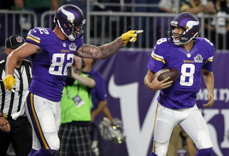 Kyle Rudolph (82) and Sam Bradford (8) will try to lead the Vikings back to the playoffs. (AP)