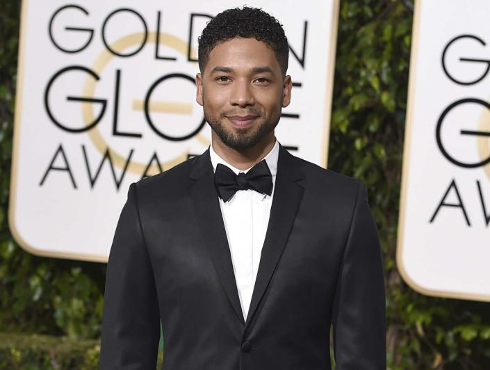"""FILE - In this Jan. 10, 2016 file photo, actor and singer Jussie Smollett arrives at the 73rd annual Golden Globe Awards in Beverly Hills, Calif. Smollett, who alleges he was the victim of a brutal racial and homophobic attack, is a former child star who grew up to become a champion of LGBT rights and one of the few actors to play a black gay character on primetime TV. His breakthrough came aboard the hip-hop drama """"Empire,"""" playing Jamal Lyon, a talented R&B singer struggling to earn his father's approval and find his place in his dad's music empire. It became one of the biggest network shows to star a gay black character. (Photo by Jordan Strauss/Invision/AP, File)"""