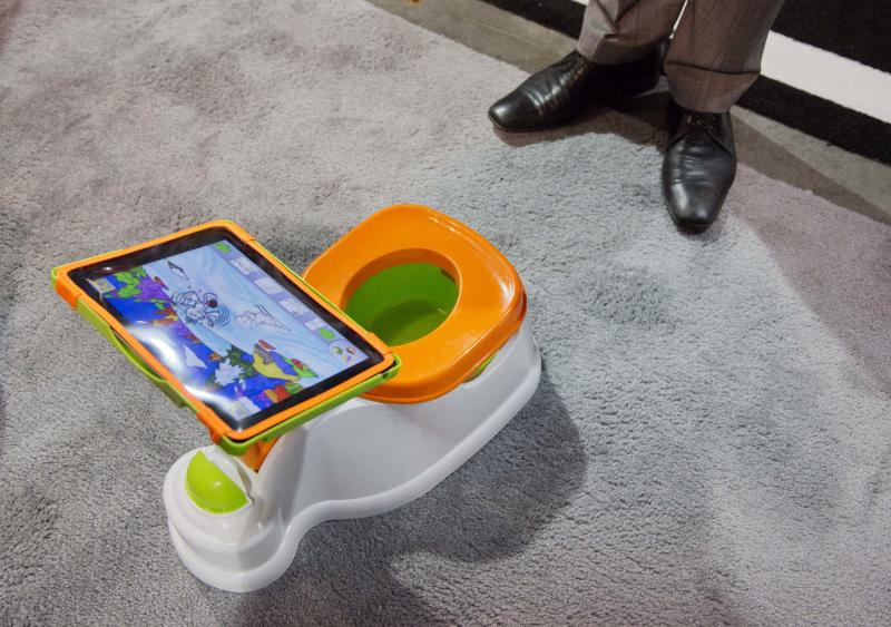 The plastic potty comes with a stand for an Apple iPad, and is designed to keep reluctant children sitting on it for as long as possible.