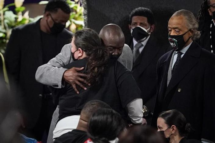 MINNEAPOLIS, MN - APRIL 21: Ben Crump hugs Katie Wright, mother Daunte Wright, during the public viewing service of Daunte Wright who was killed by a Brooklyn Center Police officer during the trail of former ex Minneapolis police officer Dereck Chauvin who was convicted for murdering George Floyd on Wednesday, April 21, 2021 in Minneapolis, MN. (Jason Armond / Los Angeles Times)