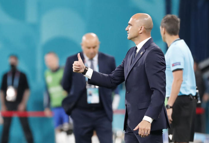 Belgium's manager Roberto Martinez gives his thumb up during the Euro 2020 soccer championship group B match between Belgium and Russia at the Saint Petersburg stadium in St. Petersburg, Russia, Saturday, June 12, 2021. (Anatoly Maltsev/Pool via AP)